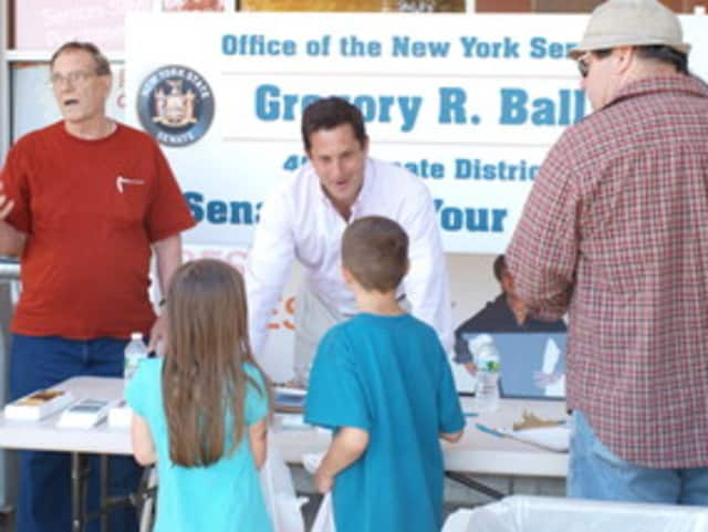 Sen. Greg Ball, center, meets with his constituents at an event last summer.