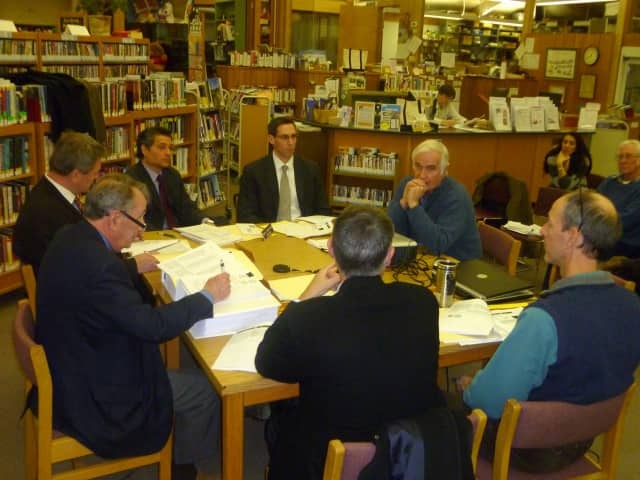 Highway Superintendent Peter Ripperger, right, discusses a plan to stripe some roads with the Lewisboro Town Board.