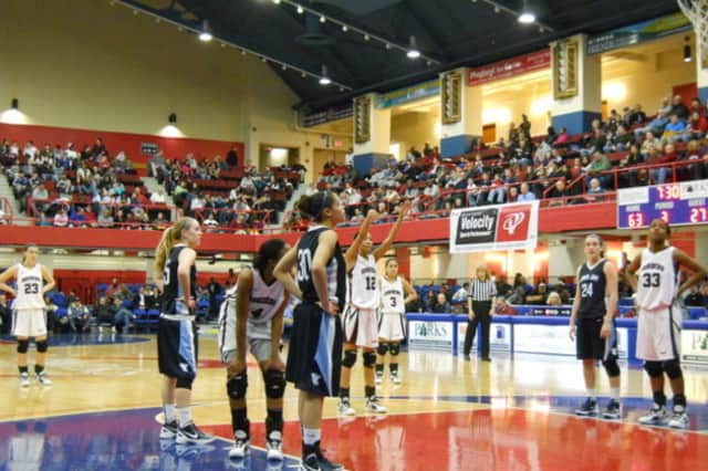Ossining High School senior Saniya Chong, center, was one of 20 girls in the country named to the 2013 WBCA High School All-America Game.