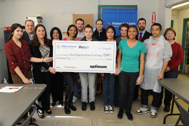 Members of Peekskill High School's Interact Club accepted a $1,000 check on behalf of the Peekskill Salvation Army. The donation comes from MSG Varsity and Cablevision.