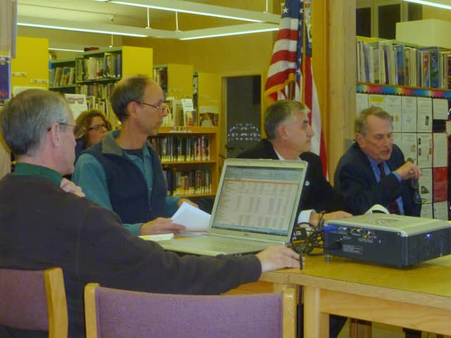 Lewisboro Comptroller Leo Masterson, with laptop, gives a budget presentation to Town Board members, from left after Masterson, Dan Welsh, Peter DeLucia and Supervisor Peter Parsons.