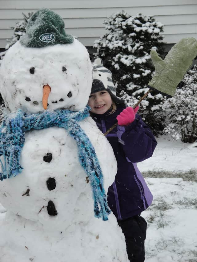 Kate Richardson, 5, with a snowman she made in Rye/Port Chester.