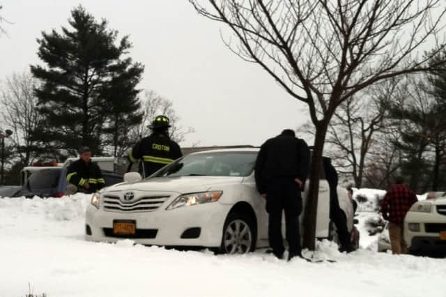 Croton firefighters freed a man whose leg became wedged in his car door when it slid on ice. The man is seen stuck in the door above.