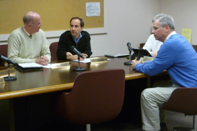 Jeffrey Rutishauser, right, talks with members of the Wilton Board of Finance on Tuesday before being elected to the board. Rutishauser previously served on the finance board from 2000 to 2004.