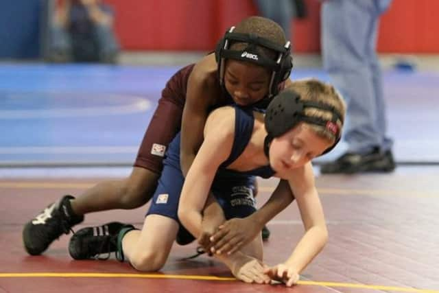 Young wrestlers with aspirations of competing in the Olympics had their dreams dashed by a decision Tuesday to drop the sport from the Summer Games beginning in 2020.