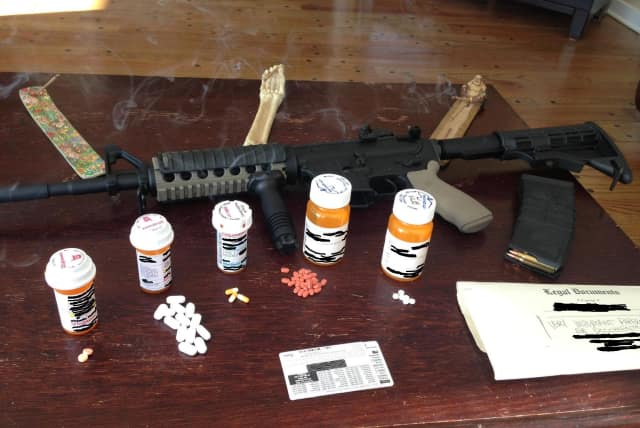 Wilton Police found a loaded assault rifle and prescription drugs in a Wilton home on Wednesday following a standoff with a man in a home in the area of Hulda Hill Road.