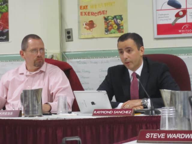 Ossining School District Interim Superintendent Ray Sanchez, right, speaks at a recent school board meeting.