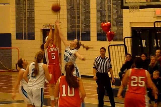 Wilton's Erica Meyer extends to defend a shot by Danbury's Rachel Gartner.