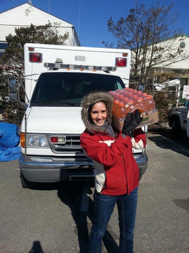 Yorktown volunteer Samantha DiPalo carries Gatorade supplied by Rocky's Deli.