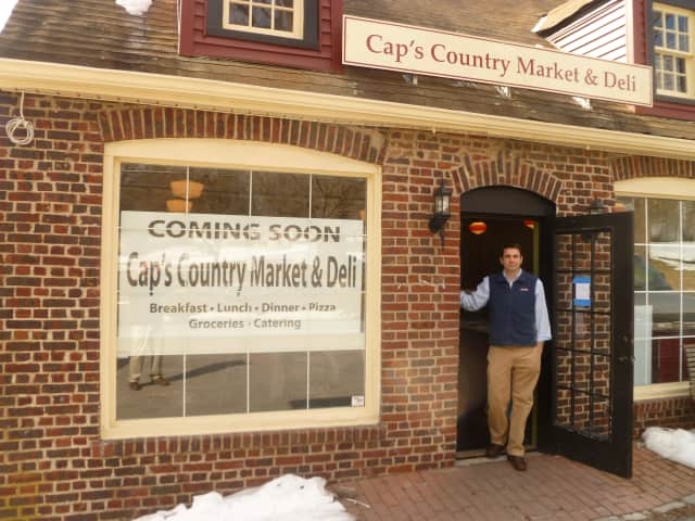 Nat Mundy stands in the doorway of the new Cap's Country Market & Deli in South Salem, which he hopes to have open the first week in March.