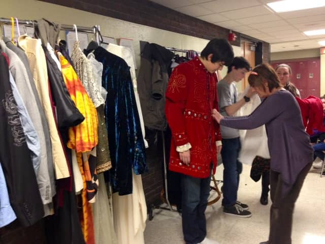 Dee O'Brien fits Mamaroneck High School senior Josh Wrobel for his Peter Quince costume.