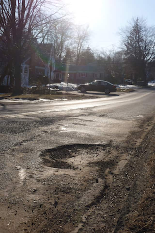 Road crews around the Hudson Valley are seeing fewer potholes like this due to the mild winter we had, public works officials are reporting.