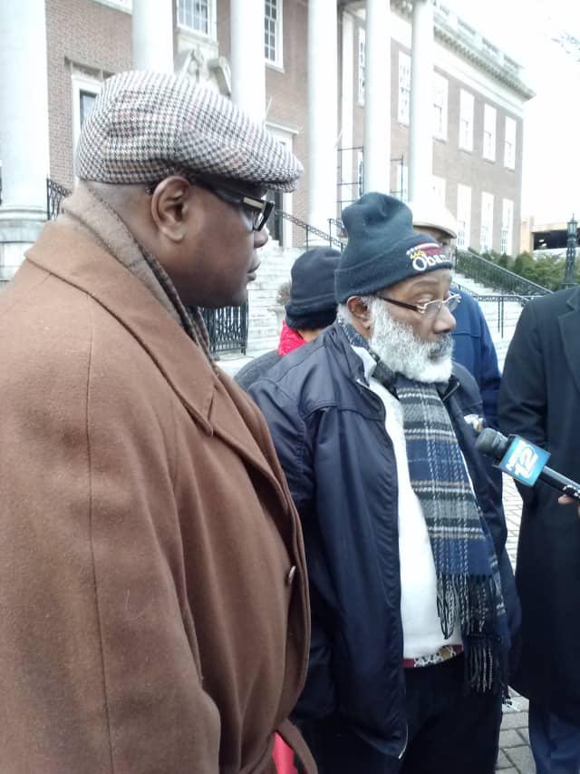 Resident Glenston Clarke (right) and Damon Jones, president of the Westchester Chapter of Blacks in Law Enforcement of America, protest the firing of former Mount Vernon Police Commissioner Carl Bell.