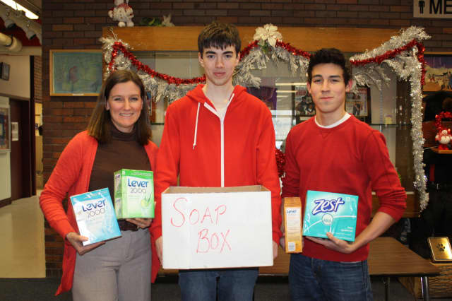 Adviser Jeanne Claire Cotnoir, juniors Myles Ellis and Gerardo Munoz and other members of Briarcliff High School's Coalition for Human Dignity, organized a schoolwide soap drive this month to collect bars of soap for refugee camps in East Africa.