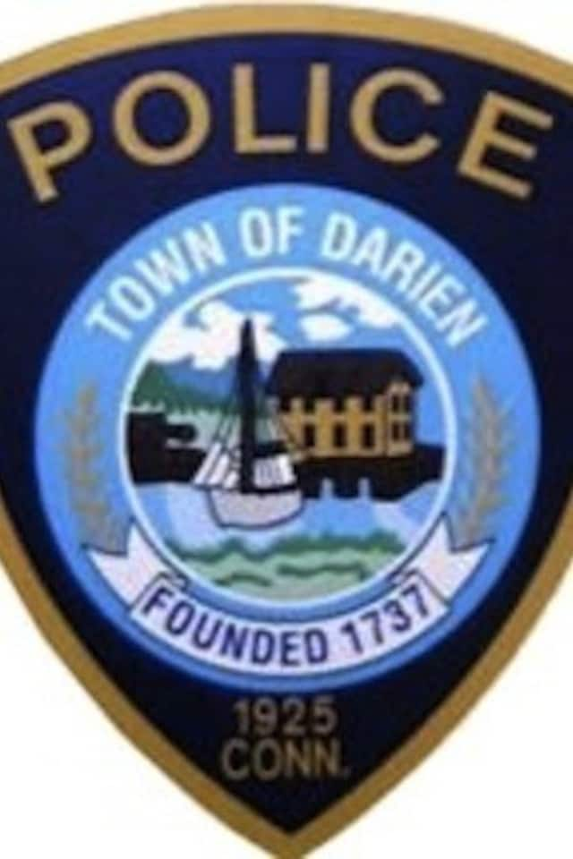 Darien Police are investigating the theft of two purses from a car which had its windows smashed
