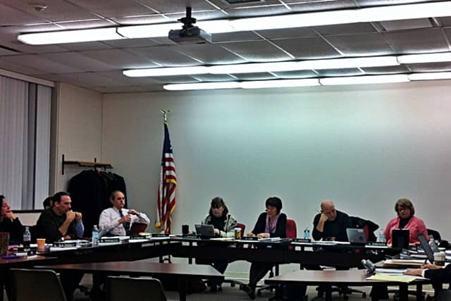 The Ridgefield Board of Education cut its overall budget for 2013-14 after the final negotiations for health benefits saved an additional $325,000.