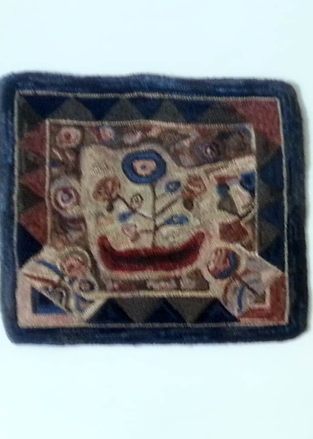 """This hooked rug piece by Mary Parker, titled """"Vintage Floral,"""" reportedly was stolen from an exhibit at the Pound Ridge Library"""
