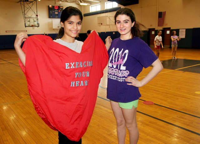 Westlake Middle School students Bianca Maniglia, left, and Caitlyn Lyions pose during the Hoops for Heart event.