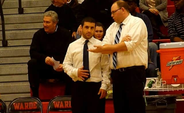 Wilton boys basketball coach Joel Geriak, right, confers with Brandon Tegano during a timeout in Tuesday's game.