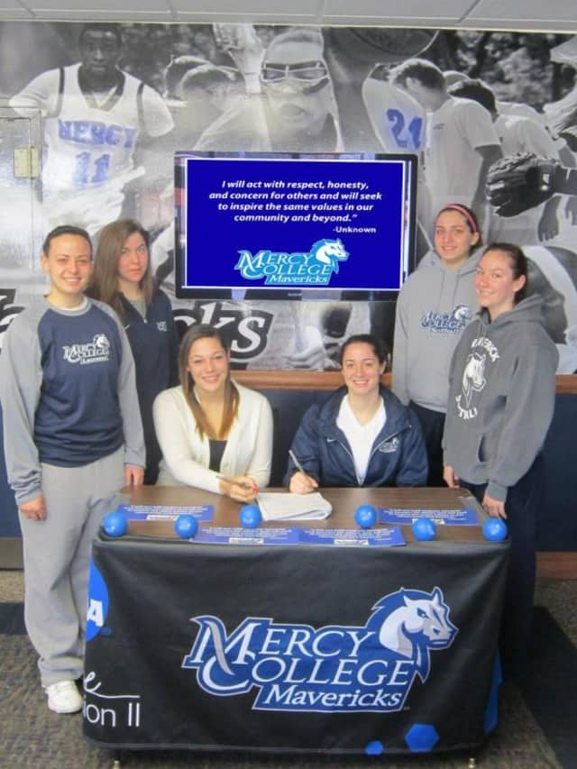 Mercy College student-athletes sign a pledge to encourage good sportsmanship and integrity on campus and in the community.