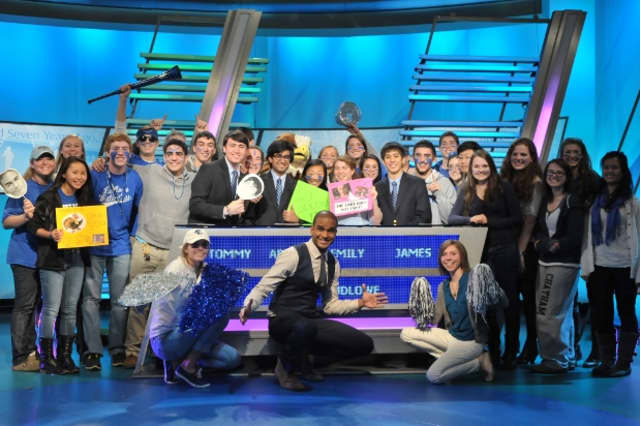 """Fairfield Ludlowe's team poses with their fans and """"The Challenge"""" host Jared Cotter after its second-round match earlier this year."""