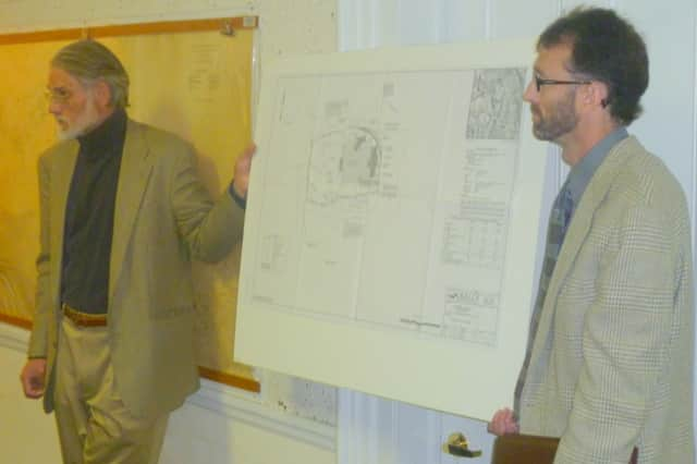 Architect Donald MacDonald, left, and John Watson of Insite Engineering, show the plans for the expansion of the Lewisboro Library to the Planning Board at a meeting last year. The plans have now received all the necessary approvals.