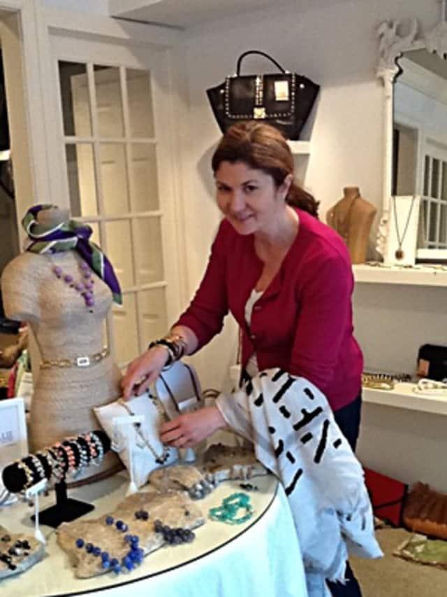 Danielle Verrilli, owner of Audrey Road, prepares for next week's Ridgefield Education Foundation fundraiser.