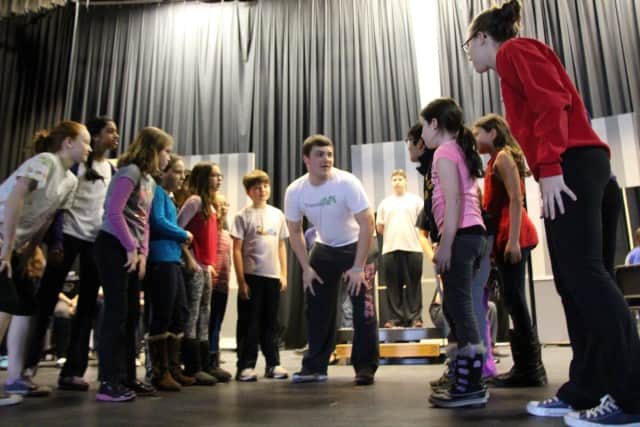 "Briarcliff High School drama students work with students from Todd Elementary School at a rehearsal for ""The Music Man."""