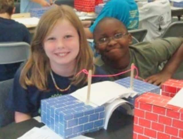 Young engineers with their bridge designs.