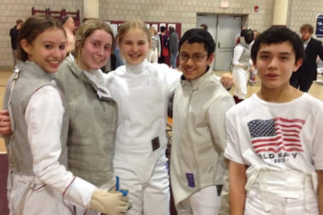 Wilton High School fencers (from second left) Megan Roughan, Tessa Markham, Jai Nagpal and Liam Smith at Saturday's state fencing tournament. With them is Zoe Howard from Weston.