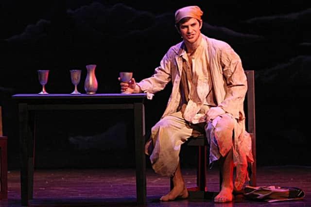 "Ridgefield High School senior Sam  Gravitte plays Jean Valjean this year in the school's production of ""Les Miserables."""