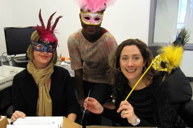From left, Jennifer Allbee, Nadine Wilf and Michele Klink prepare the invitations for Wilton Library's annual Beyond Words benefit.