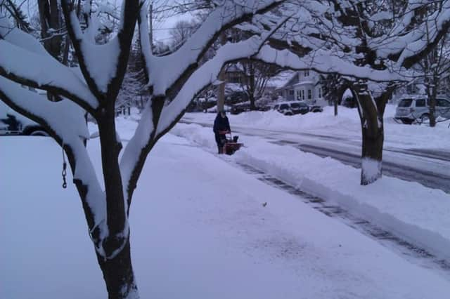Reader photo: A Westschester County resident clears snow during last month's blizzard.