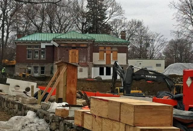 From the back of the historical  Ridgefield Library site on Main Street, it looks busy. But some are concerned that the construction may not be done on time.