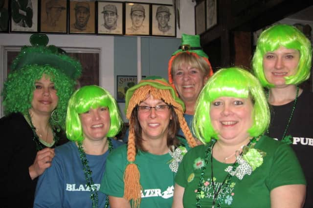 The waitresses at Blazer Pub in Purdys will serve up beer and corned beef at this weekend's St. Patrick's Day auction.
