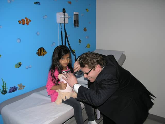 Dr. Jason Lupow does a check up at MDxpress' teddy bear clinic in Mamaroneck.