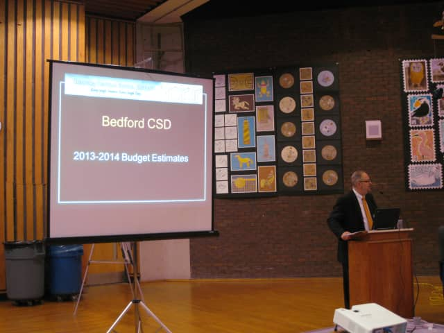 Bedford Central School District Assistant Superintendent Mark Betz helps present a preliminary 2013-14 school district budget.
