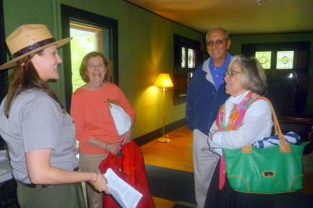 Ranger Kristen Lessard gives a tour before the restoration work was finished in the Weir Home in Wilton and Ridgefield.