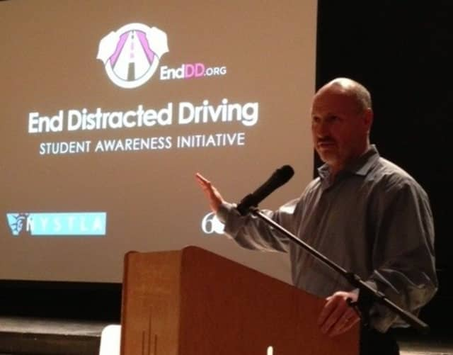Chappaqua resident Rob Greenstein speaks to more than 200 Horace Greeley High School students and parents Tuesday night about distracted driving.