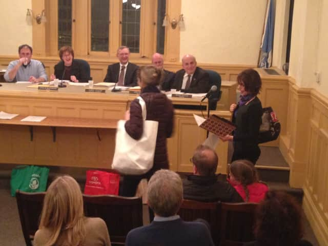 Proponents of the Reusable Bag Initiative show off their bags at Larchmont's public hearing on the legislation Tuesday.