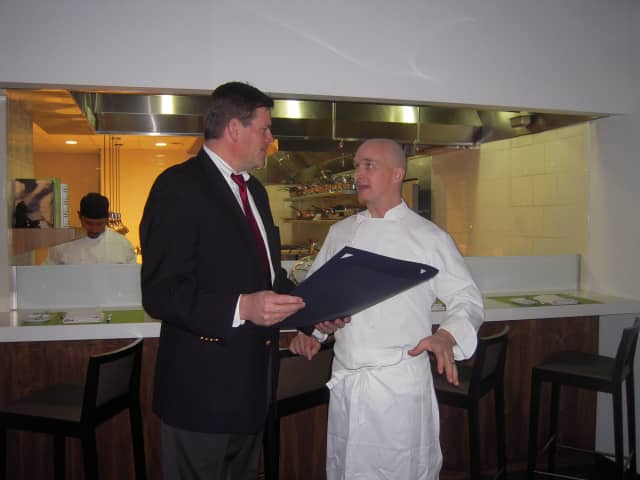 State Rep. Tom O'Dea, R-125, meets with Brian Lewis, owner and chef at Elm Restaurant in New Canaan, to celebrate his first anniversary in business.