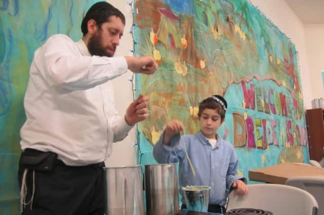 Rabbi Dovid Labkowski, left, and Chabbad of Briarcliff Manor and Ossining will hold holiday services this week for Passover.