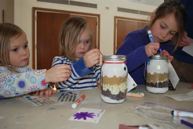 """From left, Keeley Strine and Grayson Strine, of New Canaan, and Janie Walsh, of Wilton, decorate """"Jars of Joy"""" for Family and Children's Agency as part New Canaan Country School's Community Service Day on March 9."""