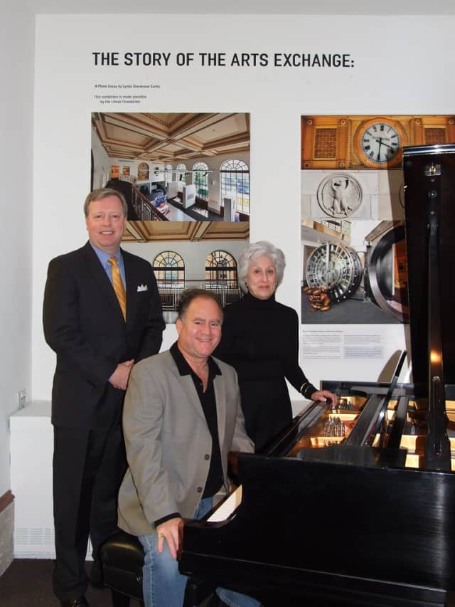 2013 Arts Award Artist winner and Yorktown native Craig Schulman, center, helps plan the Thursday awards luncheon. Also pictured are First Niagra Bank Regional President David Ring, left, and ArtsWestchester President Jacqueline Walker.