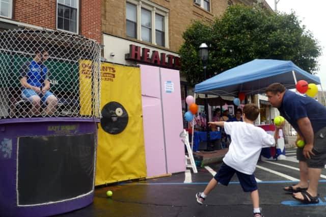 Rain didn't keep people away from last summer's Ossining Village Fair.