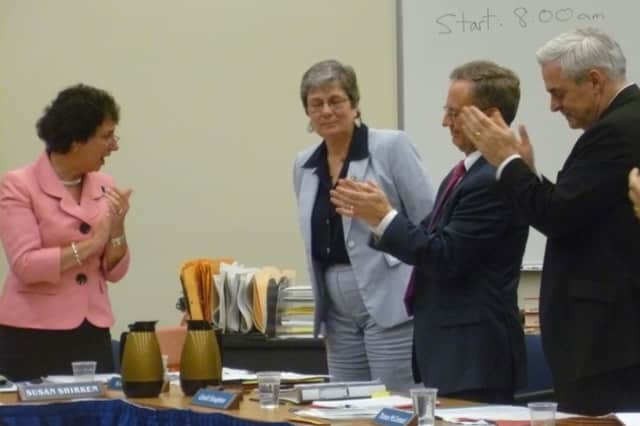 Edgemont Superintendent Nancy Taddiken (center) was given a standing ovation by members of the Edgemont Board of Education Tuesday after she announced her decision to retire at the end of the 2012-13 school year.