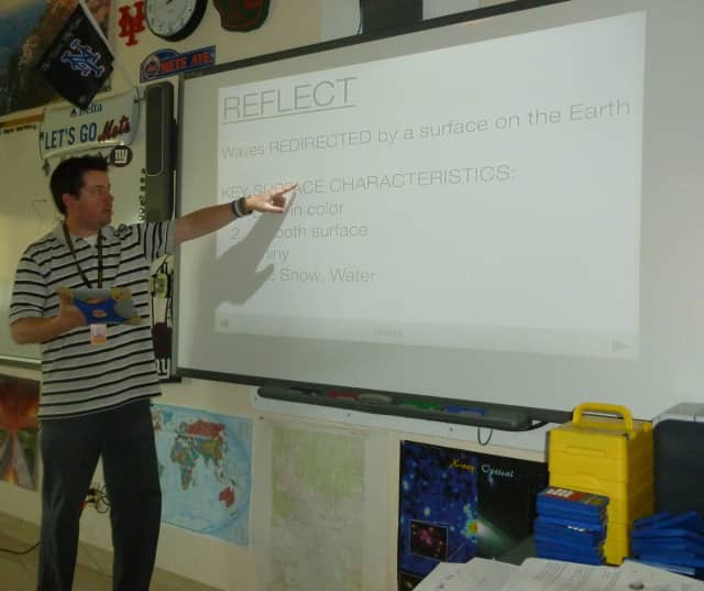 Michael Wing, a teacher at the Hommocks Middle School, uses iPads as a platform for his earth science lessons.