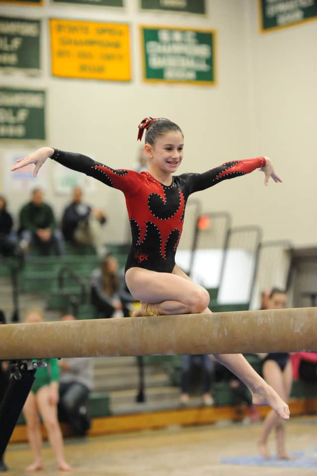 Wilton's Jessica Olin finished second all-around at the 11-year-old, Level 7 state gymnastics championships.