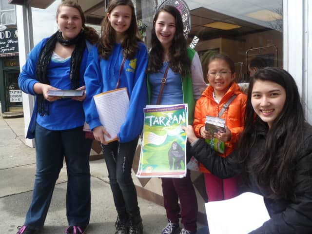 """Broadway Training Center cast members distributed play posters in downtown Hastings for their upcoming production of """"Tarzan""""."""