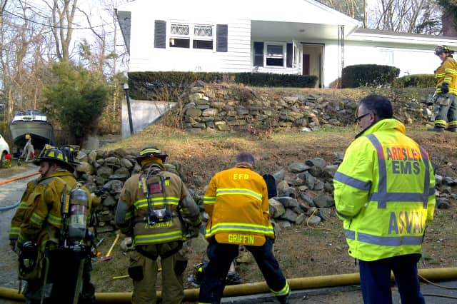 Elmsford firefighters work at the scene of a house fire. The department, along with the fire departments in Hartsdale and Fairview, is set to see thousands of dollars from a federal government grant program..